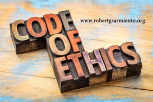 code of ethics banner - word abstract in letterpress wood type printing blocks stained by inks